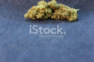 Marijuana displayed against a black background